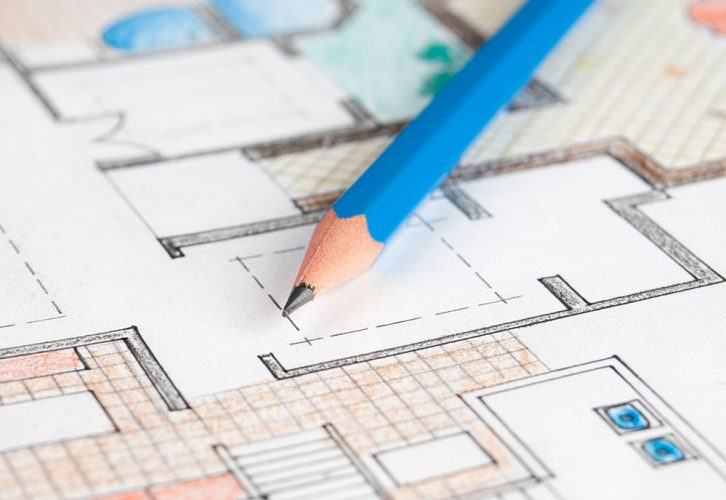 Home floor plan with blue pencil