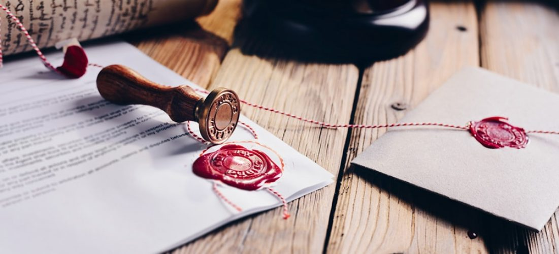 Notary public wax stamper and wax seal on document