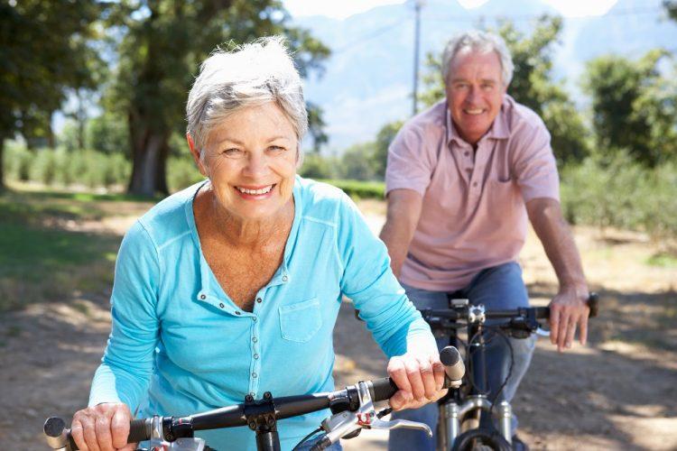 Senior couple enjoying country bike ride together